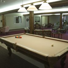 Pool table in the game room. Senior entertainment and fun things to do.